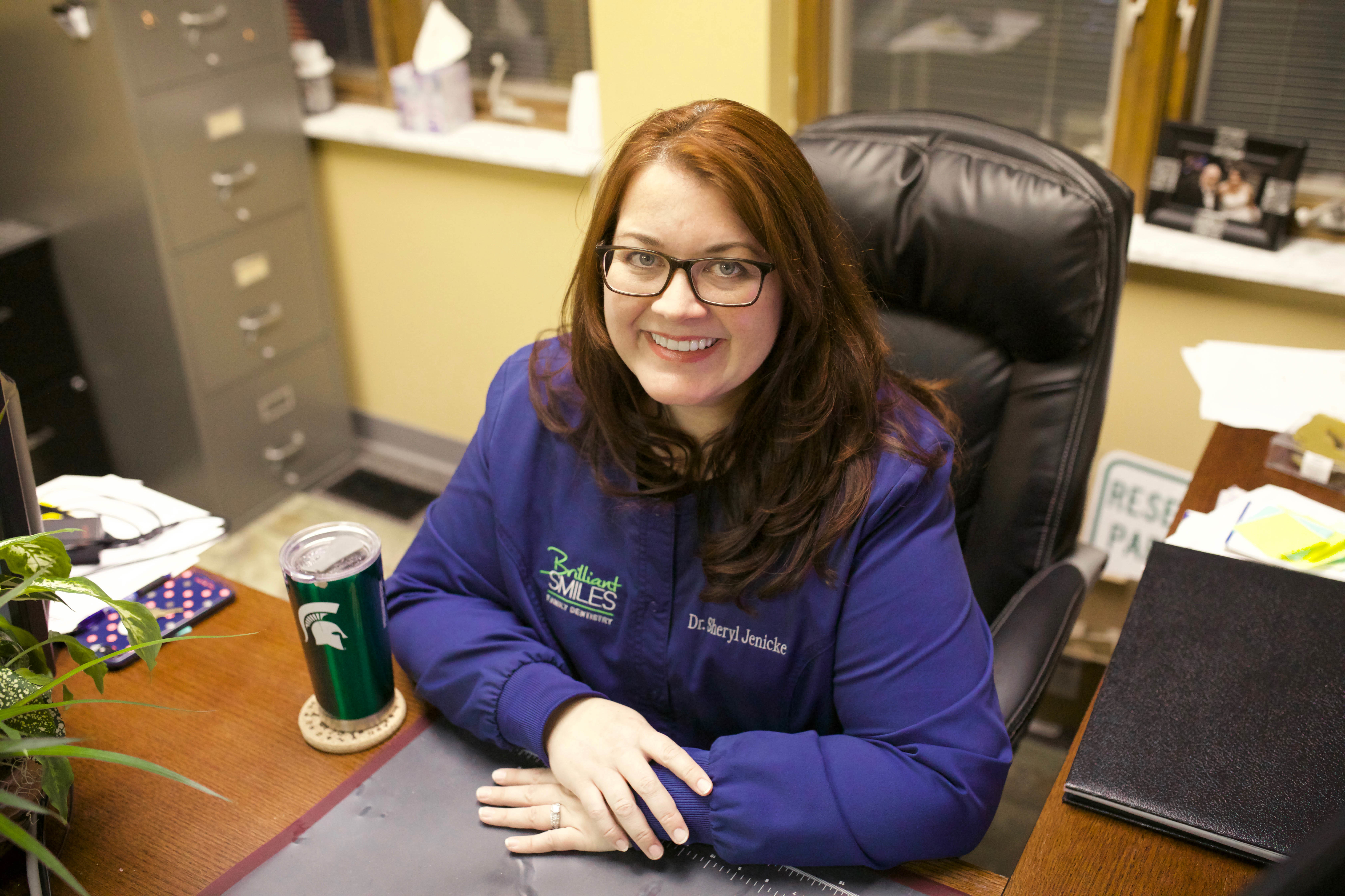 Dr. Jenicke in her office (yes she is a Spartan).